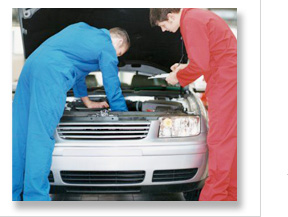 mechanics inspecting a car engine